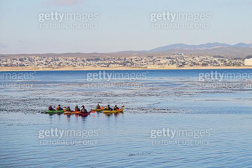 Kayaking tourists in Monterey Bay, California