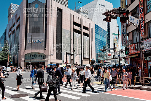 Shinjuku with crowd people downtown in Tokyo Japan. It is a major commercial and administrative centre.