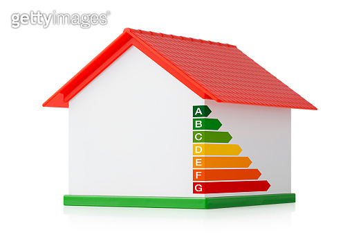 Miniature model house with energy efficiency graph. Photo with clipping path.