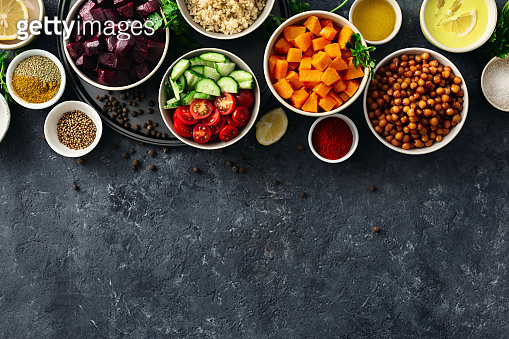 Set food cooking healthy vegetarian food Spiced chickpeas baked pumpkin and beets quinoa and vegetables on dark stone background with copy space top view