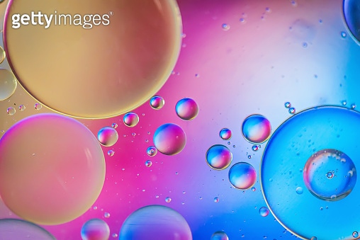 Multicolored abstract defocused background picture made with oil, water and soap
