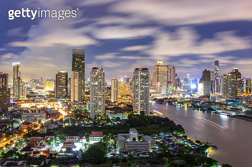 Bangkok City skyline aerial view at night time and skyscrapers of midtown