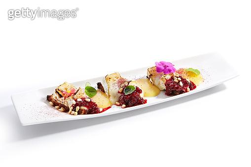Beetroot carpaccio with stracciatella cheese close up