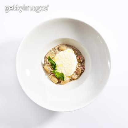 Gnocchi in mushroom sauce with cheese espuma