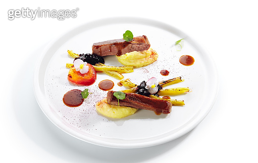 Fried Duck Breast with Baked Plum and Glazed Rhubarb Isolated