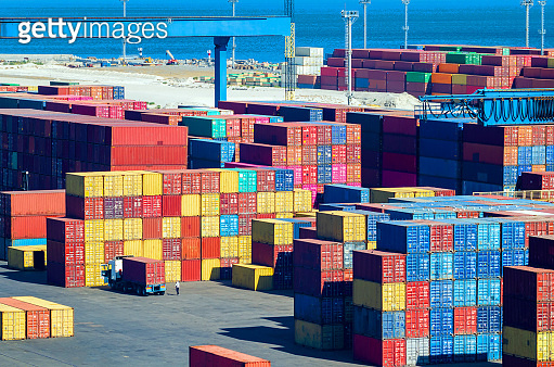 Stacked cargo containers in storage area of freight sea port