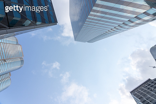 Low view of skyscrapers with blue sky and clouds and Office building modern business in hong kong.