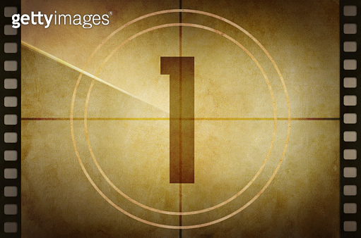 Vintage old film projector countdown screen with the number 1 at the center