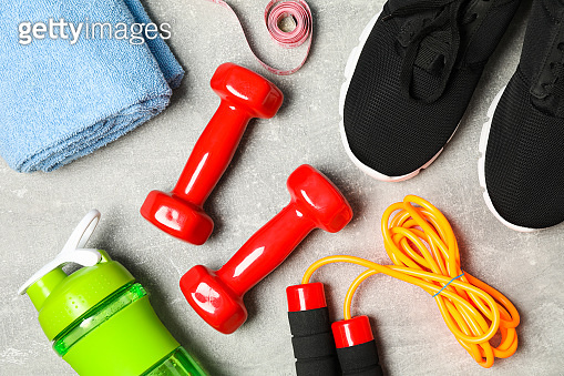 Composition with healthy lifestyle accessories on grey background