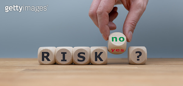 Taking a risk? Hand turns a dice and changes the word 'yes' to 'no'.