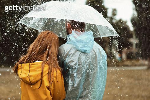 Man and woman walking in rain