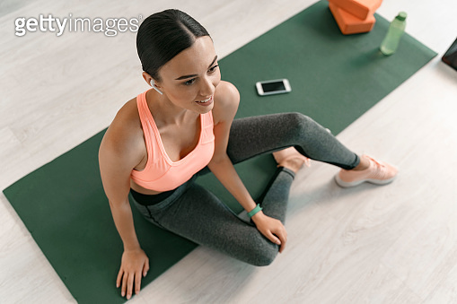 Cheerful female listening to music during workout stock photo