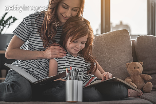 Woman and child drawing with enjoyment