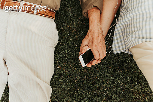 Man and woman bonded with modern smartphone