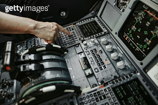 Caucasian man working in cabin of airliner