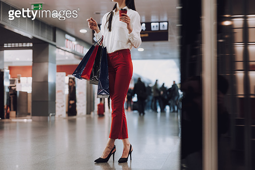 Elegant young woman is shopping in airport