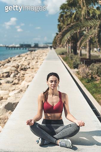 Happy lady sitting in lotus posture