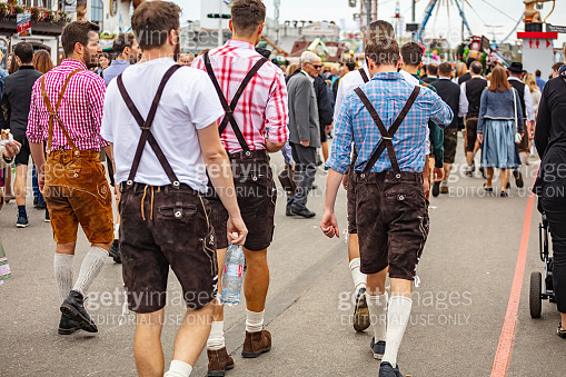 Munich, Germany, Oktoberfest, Group of young men in traditional costumes walking