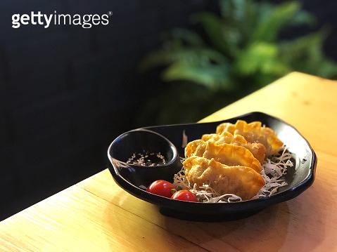 Gyoza dumplings on white dish,popular Japanese food, plate of Japanese gyoza