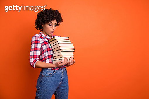 Close up side profile photo beautiful she her model lady oh no expression open mouth hold arms hands many books examination stupor wear casual checkered plaid shirt isolated bright orange background