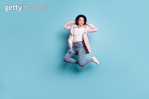 Full size photo of cute charming girl hipster jump send air kiss to her boyfriend have date isolated over blue color background