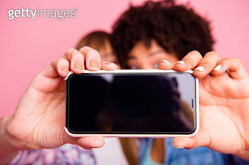 Cropped close-up view of two person nice charming girls making taking selfie with new product day dream vacation isolated over pink pastel background
