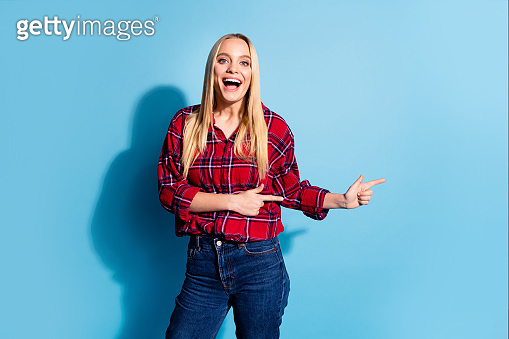 Portrait of cheerful trendy satisfied student impressed astonished news information give advice choice feedback attention option decide advert dressed plaid denim outfit isolated blue background