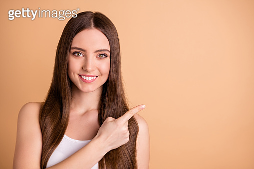 Close up photo of cue pretty teen youth feel glad choice decision advise look attention news salon beauty smoothing straightening procedures wear white top singlet isolated beige pastel background