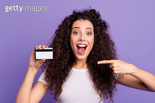 Close-up portrait of her she nice cute attractive cheerful cheery wavy-haired lady showing new cool card wireless purchase advice isolated on bright vivid shine violet pastel background