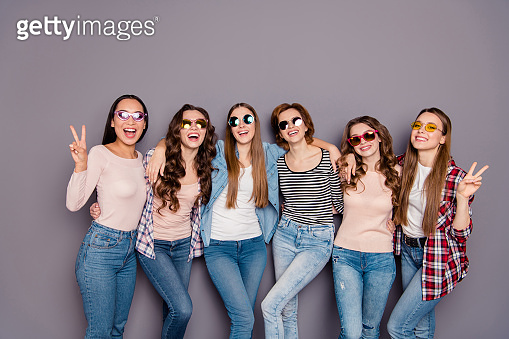 Close up photo beautiful she her six ladies skinny roommates hands arms show v-sign go abroad buddies holidays wearing casual jeans denim checkered striped clothes outfit isolated grey background