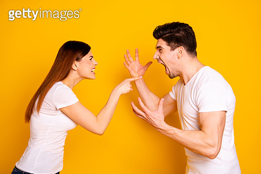 Profile side view portrait of his he her she two attractive angry aggressive nervous annoyed irritated people having fight anger blame isolated over vivid shine bright yellow background