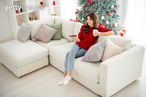 Top above and high angle photo of cheerful cute girl wearing comfort jeans denim footwear having relax in front of television
