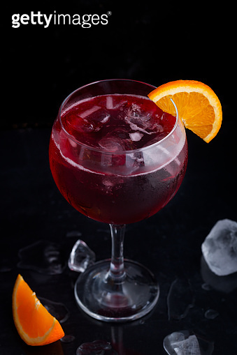 Fresh red colorful alcoholic cocktail Sangria with lemon and ice