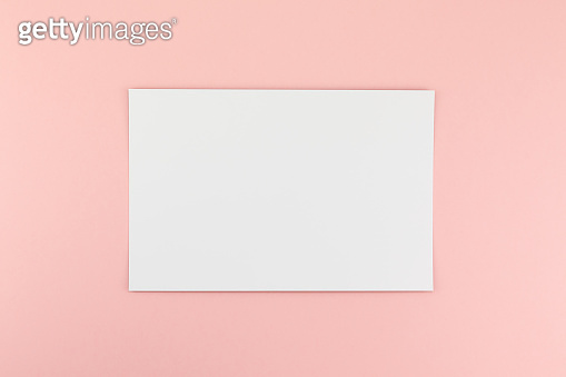 Blank A4 paper sheet mockup on pink background