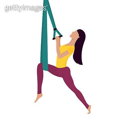 Girl doing fly yoga with aerial hammock