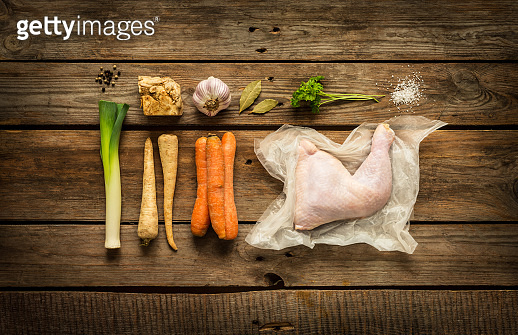 Chicken stock (bouillon, soup) ingredients on wood