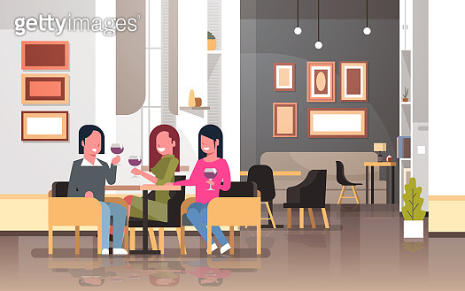 women drinking wine international happy 8 march day holiday concept girls sitting at cafe table modern restaurant interior ladies holding glasses horizontal flat
