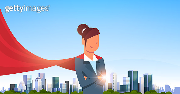 businesswoman wearing red super hero cape representing business power and courage leadership success concept over big modern city skyscraper cityscape horizontal flat