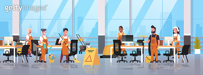 janitors team cleaning service concept male female cleaners in uniform working together with professional equipment modern co-working center office interior flat full length horizontal