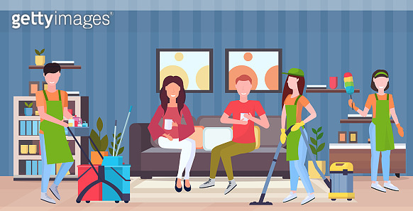 janitors team cleaners in uniform working together with professional equipment cleaning service concept couple sitting on couch modern living room interior flat full length horizontal