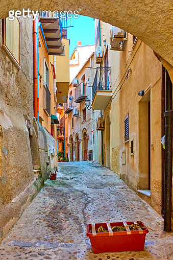 Old street in Cefalu in Sicily
