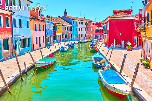 Canal and colorful houses in Burano - Venice
