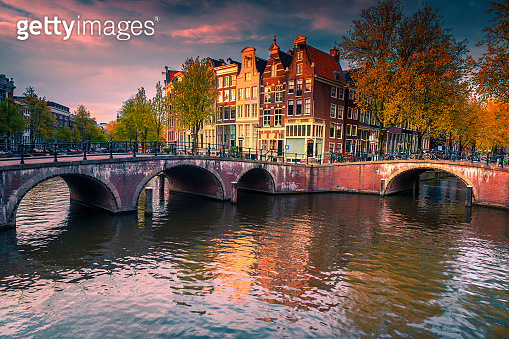 Dutch water canals and great cityscape at sunset, Amsterdam, Netherlands