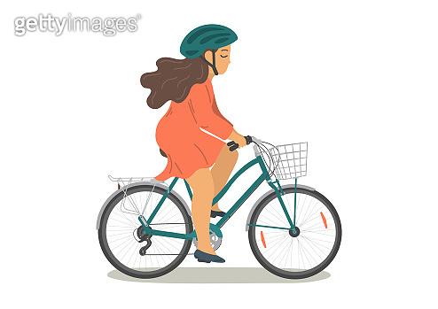 Woman in helmet on bike with basket.