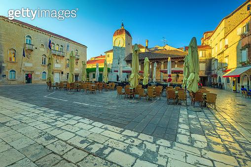Promenade with street cafe at sunrise in Trogir, Dalmatia, Croatia