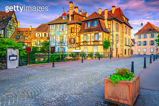 Paved street and medieval half timbered facades in Colmar, France