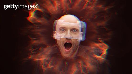 Man wearing holographic virtual reality glasses. Shock!