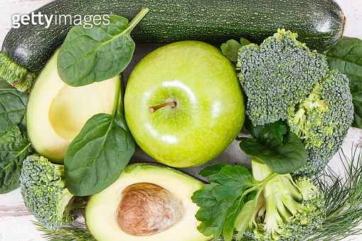 Green fruits and vegetables containing natural minerals, vitamins and fiber, healthy nutrition concept