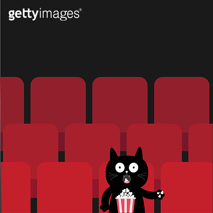 Cat sitting in movie theater eating popcorn.  Cute cartoon character. Film show Cinema background. Viewer kitten watching movie. Red seats hall. Dark background. Flat design