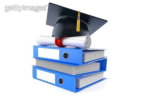 Mortarboard with certificate on stack of ring binders
